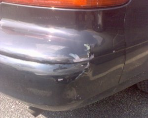 The damaged corner of my rear bumper