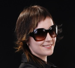 A pretty woman whose face is marred by humongous ugly sunglasses